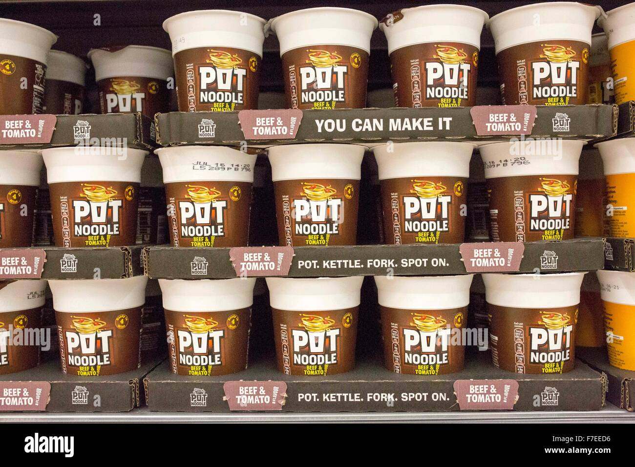 Pot Noodles on display in a supermarket - Stock Image
