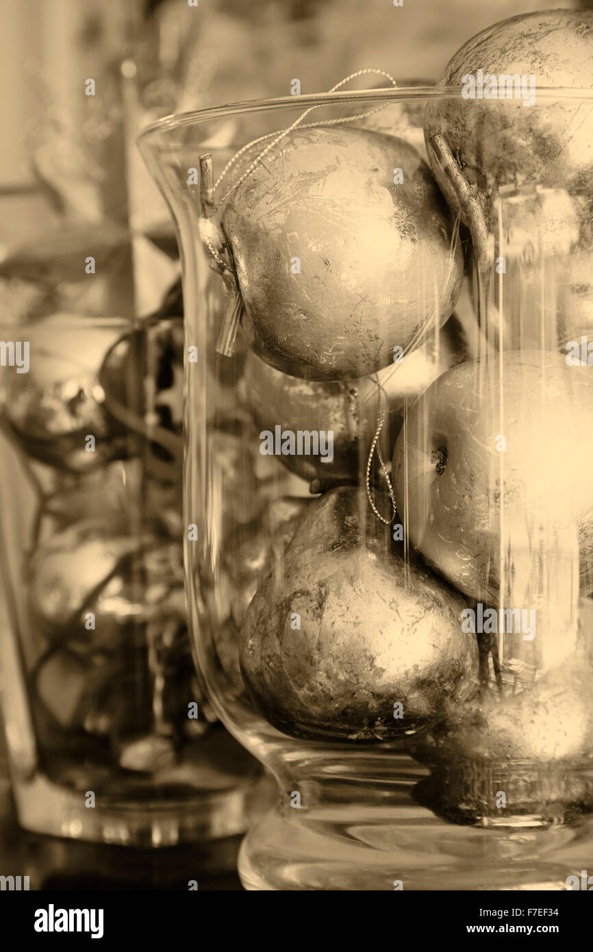 Christmas decoration: gilded apples and pears in a vase of glass. tinted black and white - Stock Image