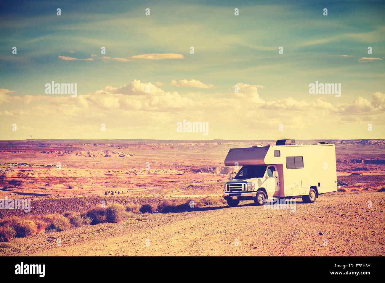 Retro toned camper parked by canyon, family vacation concept, USA. - Stock Image
