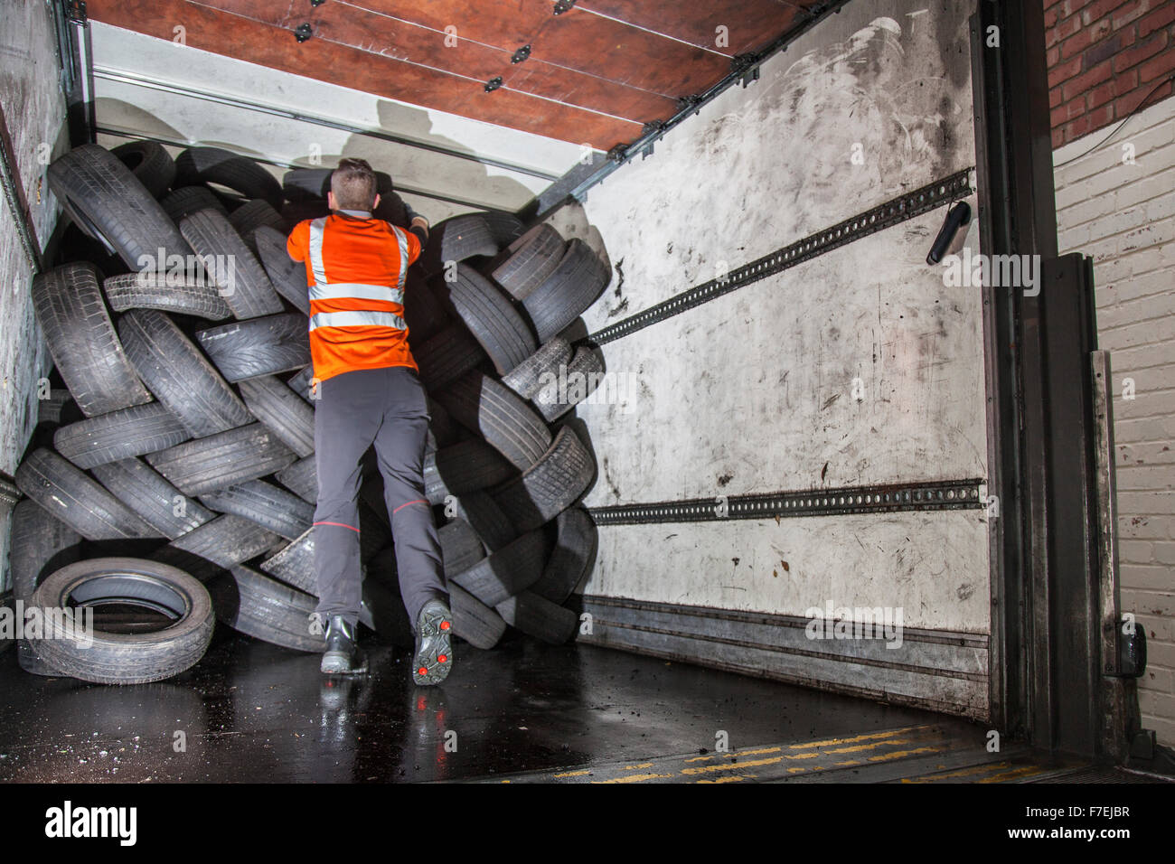 Loading used tyres for disposal, deliveries, delivery. Merseyside, UK 30th November, 2015.  Businesses such as garages - Stock Image