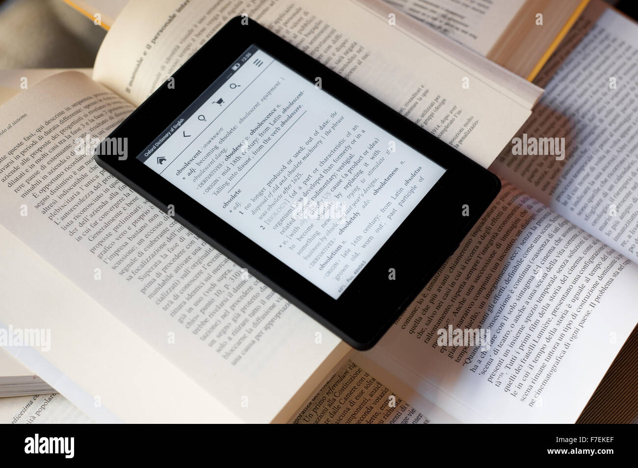 An ebook reader over several books - Stock Image