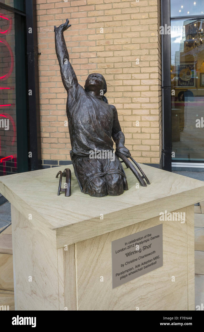 A Bronze sculpture by Christine Charlesworth, 'Winning Shot', of Paralympian, Ade Adepitan MBE playing wheelchair - Stock Image