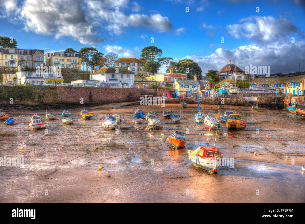 Paignton harbour Devon England uk in colourful HDR with boats at low tide and near Torquay - Stock Image