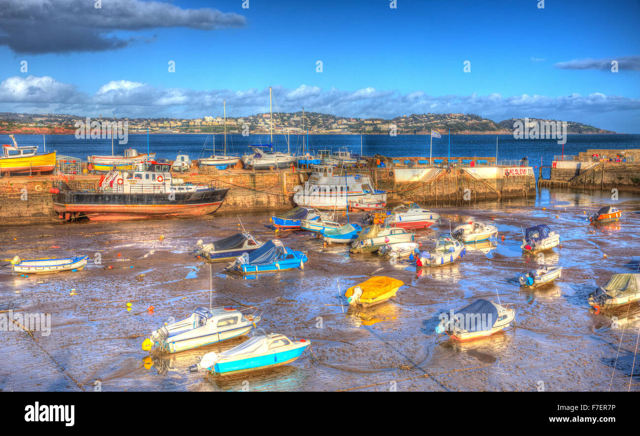 Paignton harbour Devon England uk in colourful HDR with boats at low tide and view to Torquay - Stock Image