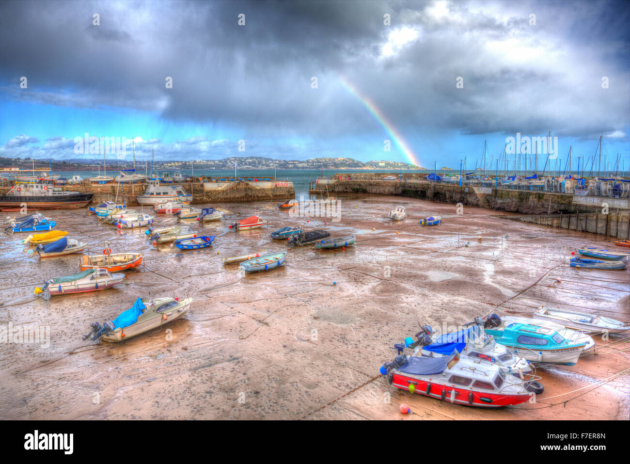 Rainbow English harbour paignton Devon England uk in colourful HDR with boats at low tide and view to Torquay - Stock Image