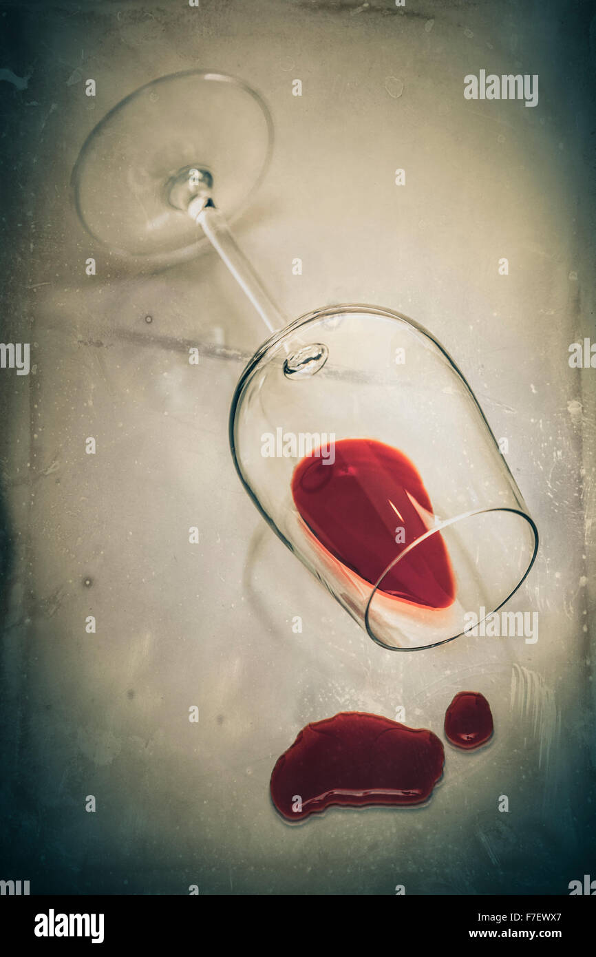 Upset glass of red wine. Stock Photo