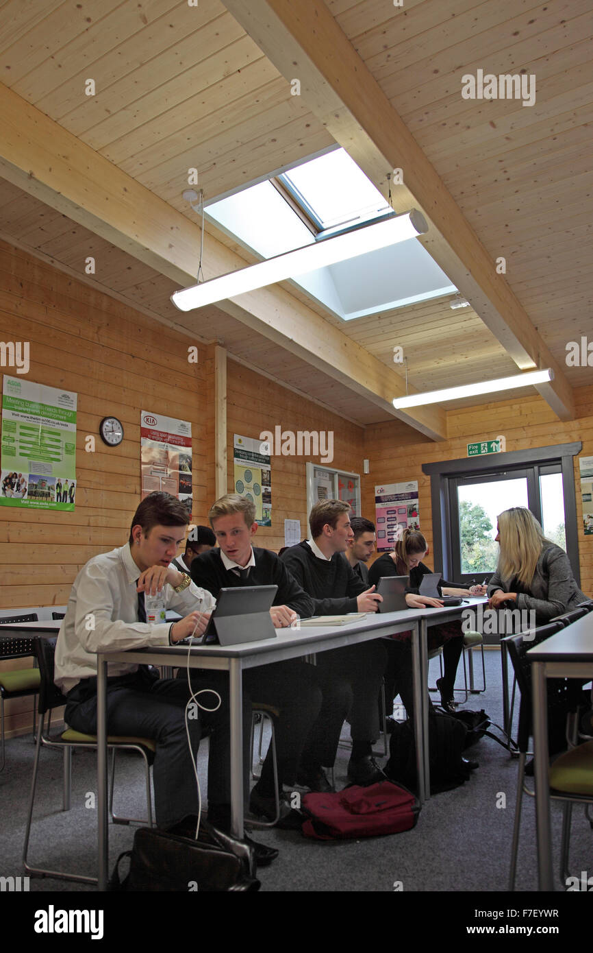 A sixth form IT class in progress in a new school built from timber Stock Photo