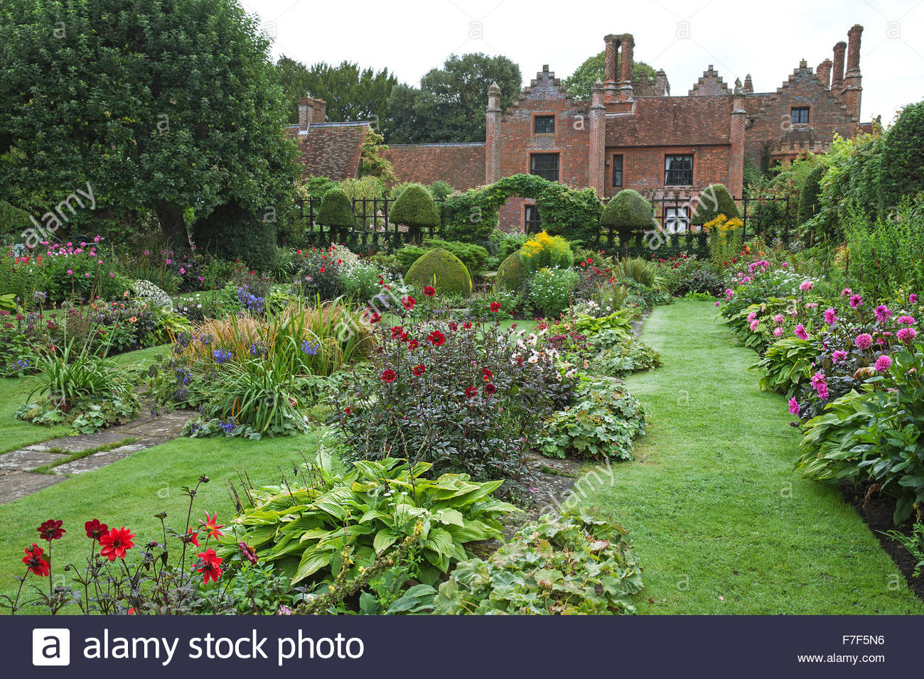 Chenies Manor House and Gardens - English Garden showing the Sunken Garden summer double borders with Dahlia and - Stock Image