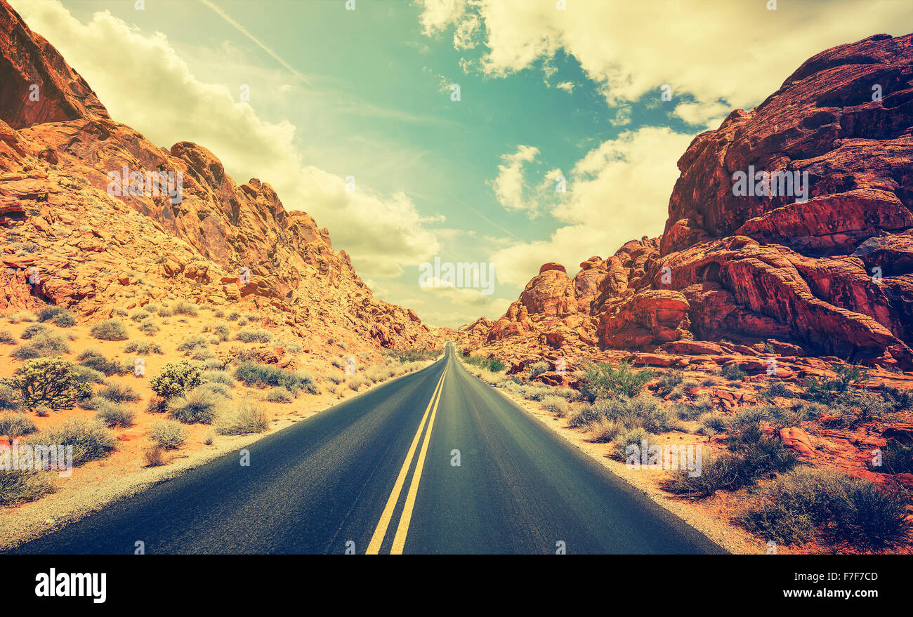 Retro stylized desert highway, travel adventure concept, USA. - Stock Image