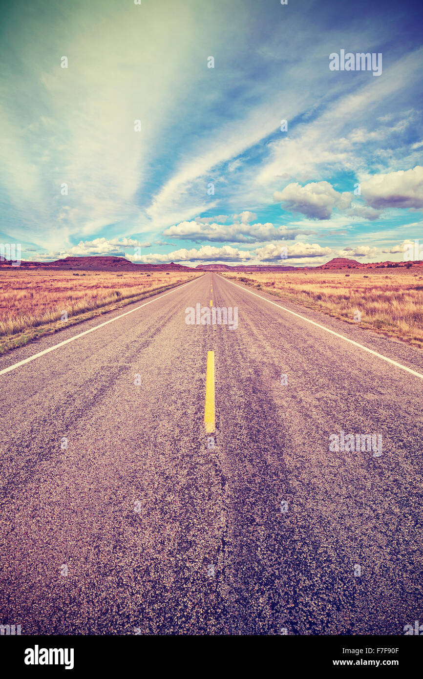 Retro stylized desert highway, travel adventure concept, USA. Stock Photo