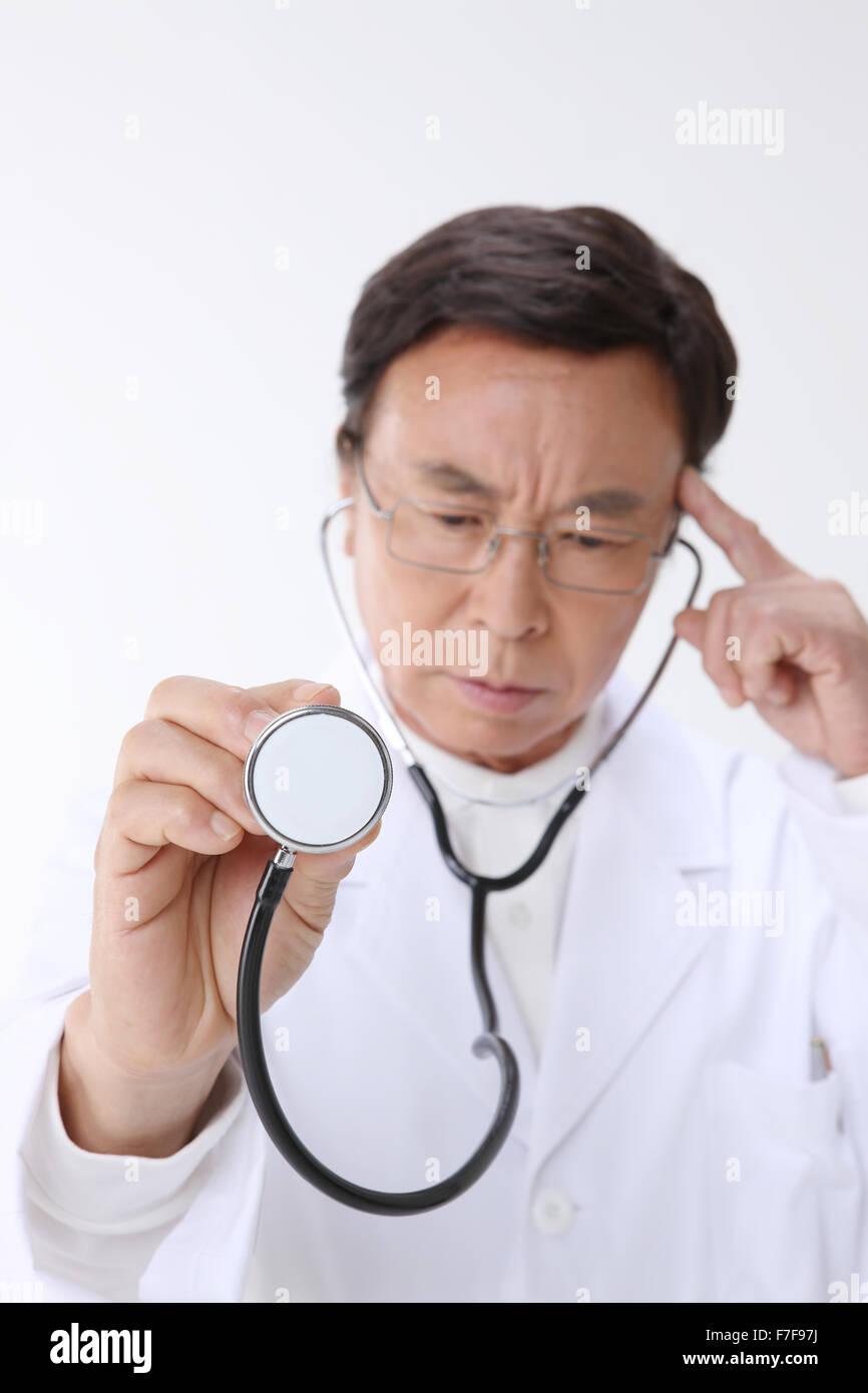 A Korean doctor examining - Stock Image