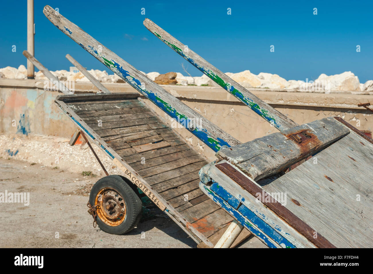 A pair of wooden barrows in the fish market area of Trapani port, Sicily. - Stock Image