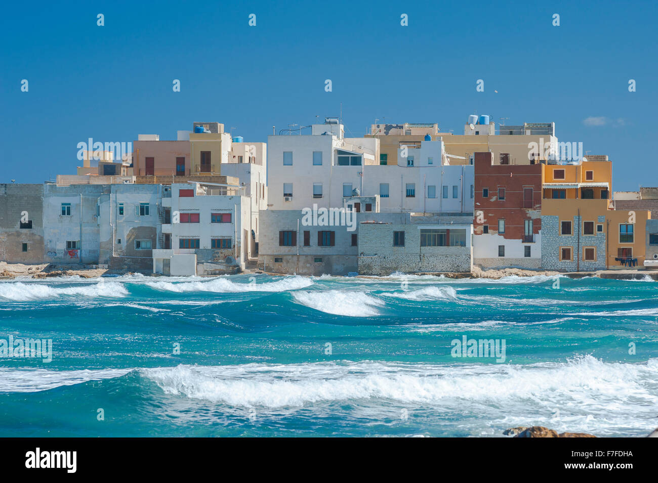 Sicily coast, waves break against the west coast of the town of Trapani, Sicily. - Stock Image