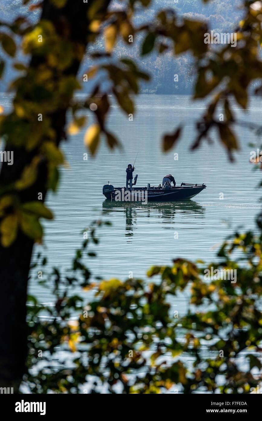 Fishing from a small motorboat on Sayers Lake, Howard Township, Pennsylvania, USA Stock Photo