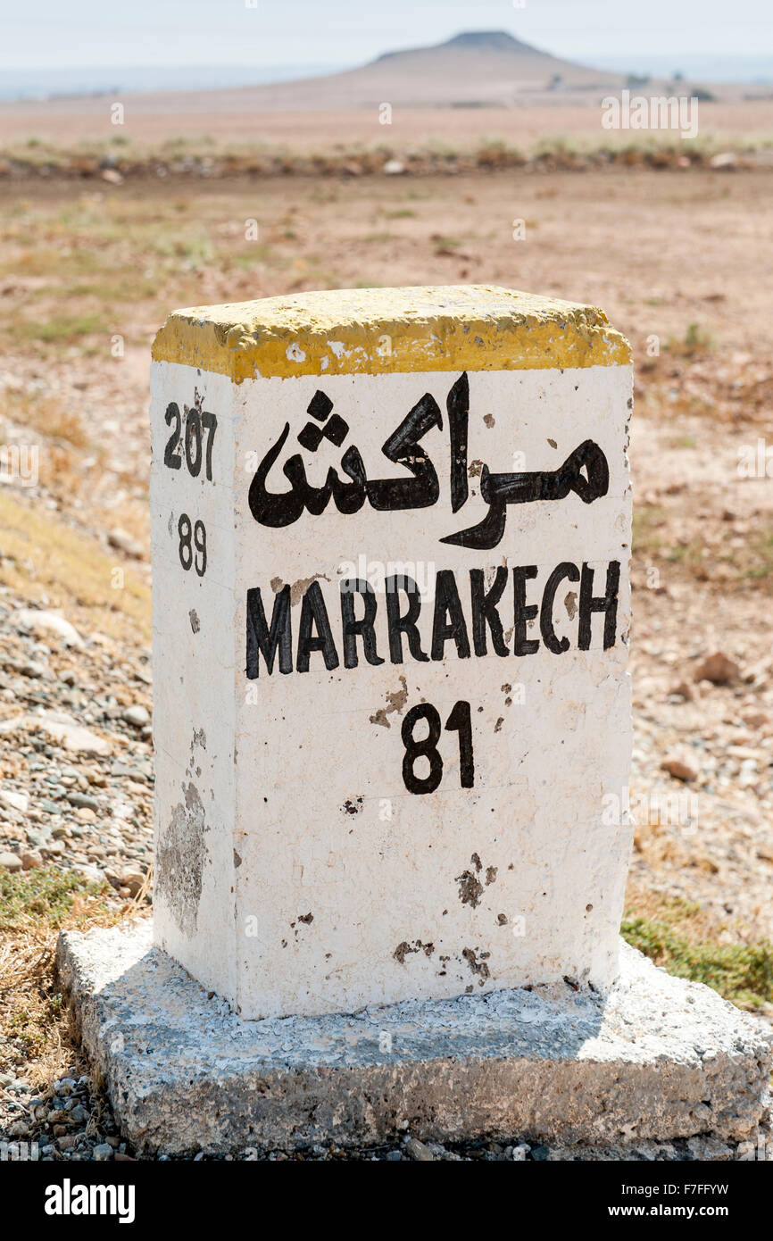 Milestone for Marrakech on the road from Essaouira in Morocco. - Stock Image