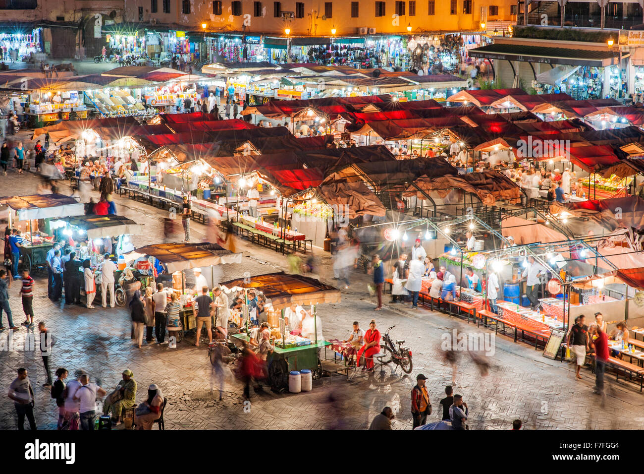 Dusk view of food stalls and crowds in Jemaa El Fna Square in Marrakech, Morocco. - Stock Image