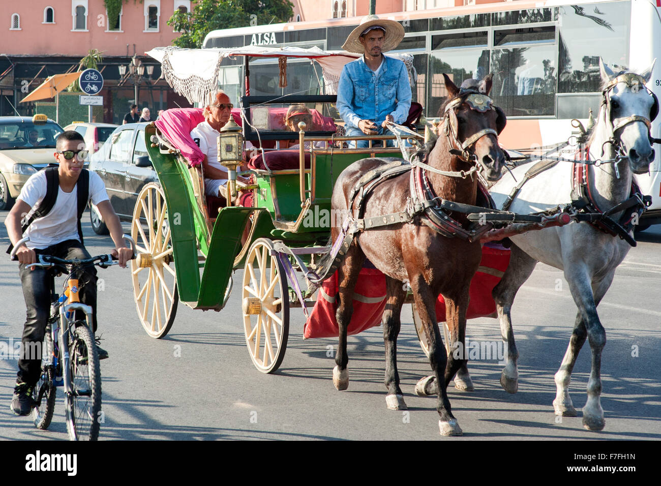 Horse drawn carriage on a street in Marrakech, Morocco. - Stock Image