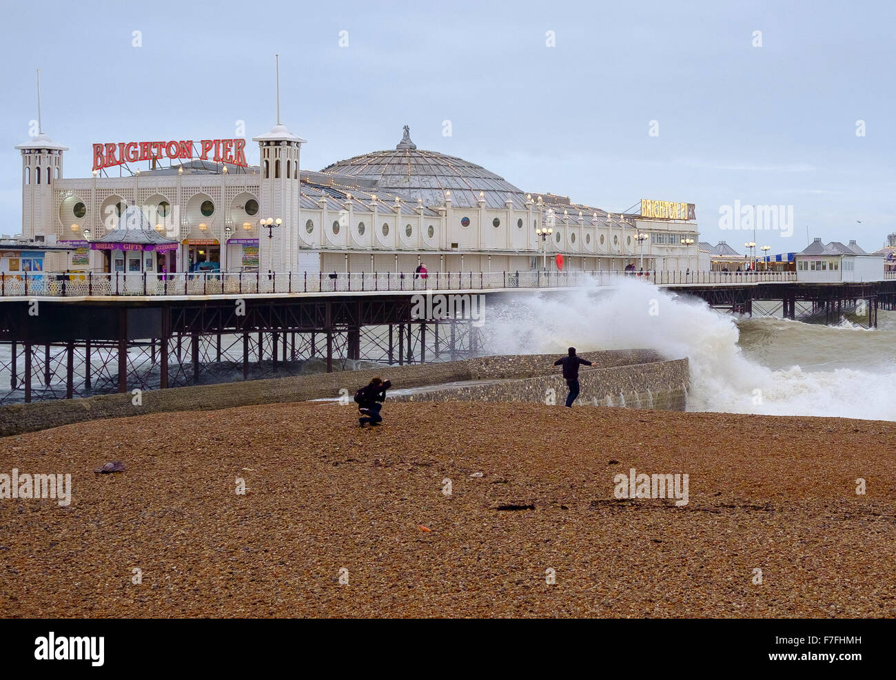 Brighton, UK. 30th Nov, 2015. With winds gusting to  60 mph and the pier in Brighton facing stormy seas,  one young - Stock Image