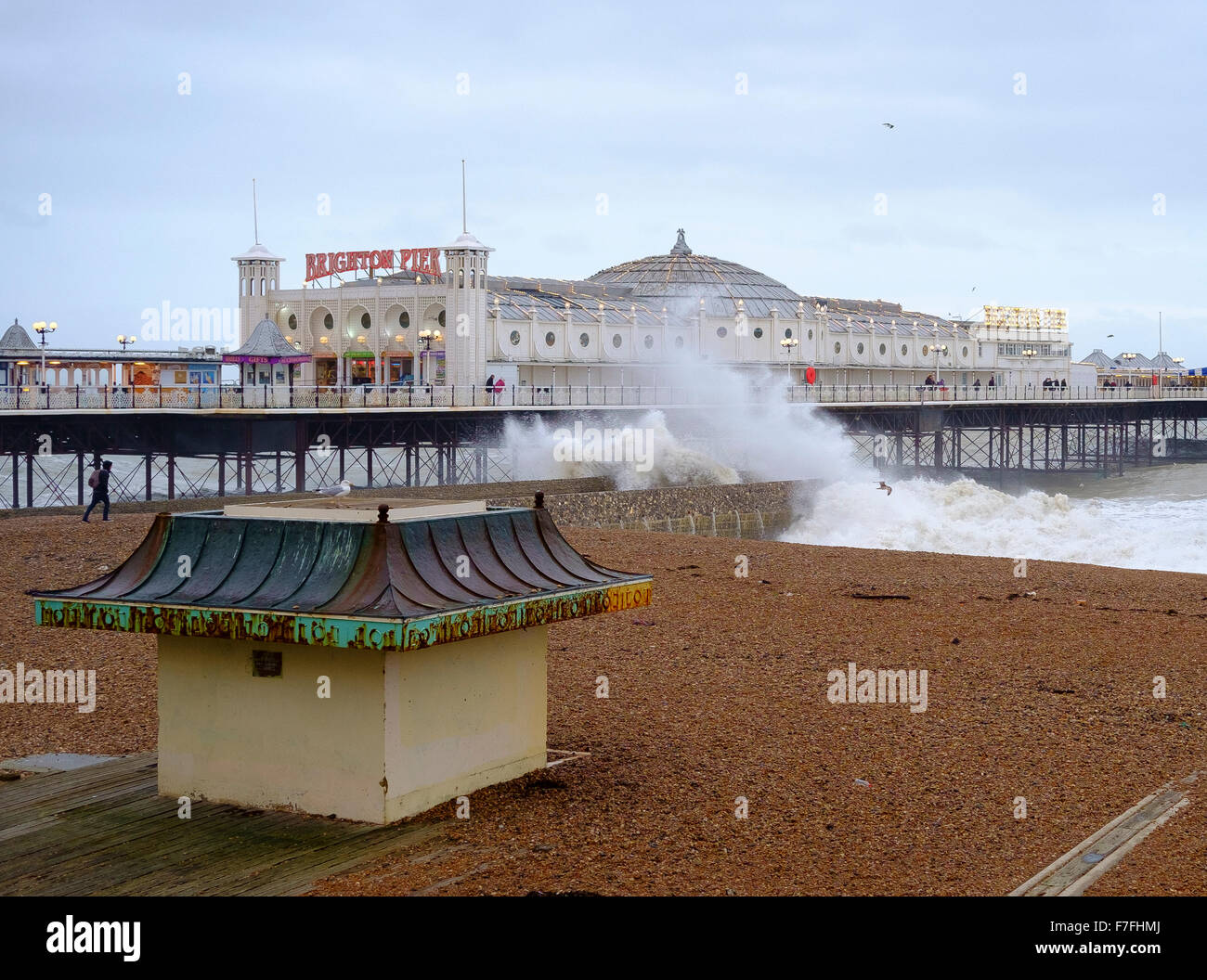 Brighton, UK. 30th Nov, 2015. With winds gusting to  60 mph, and an almost deserted beach, the pier in Brighton - Stock Image