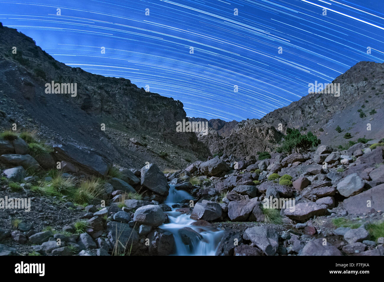 Moonlit landscape and star trails in the Tamsoult region of the Toubkal National Park in the Atlas mountains in - Stock Image