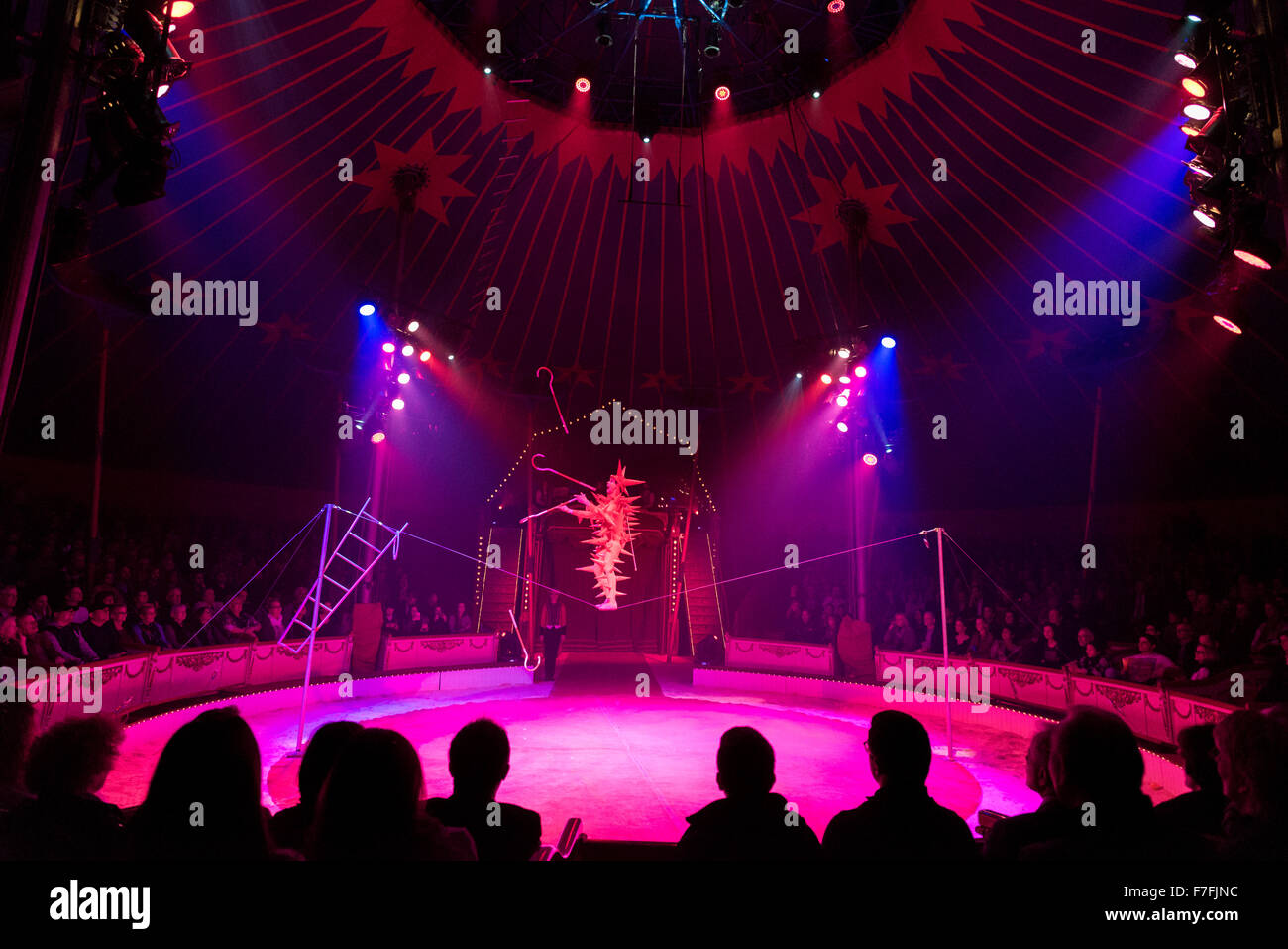 Artists of the Roncalli Circus (Andrej Ivakhnenko on a slackline) perform their show 'Salto Vitale'. - Stock Image