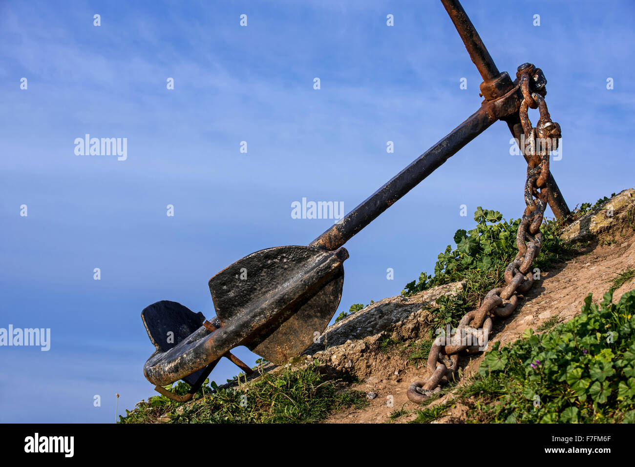 Old ship's anchor along the Brittany coast, France - Stock Image