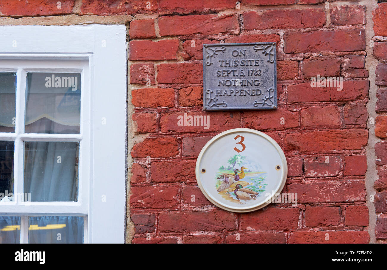 Plaque on house, on this site, nothing happened, England UK - Stock Image
