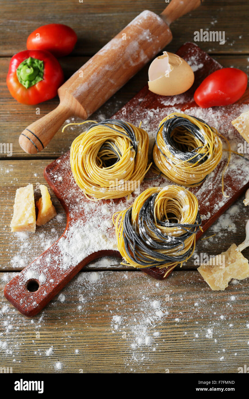 uncooked pasta on board, top view - Stock Image