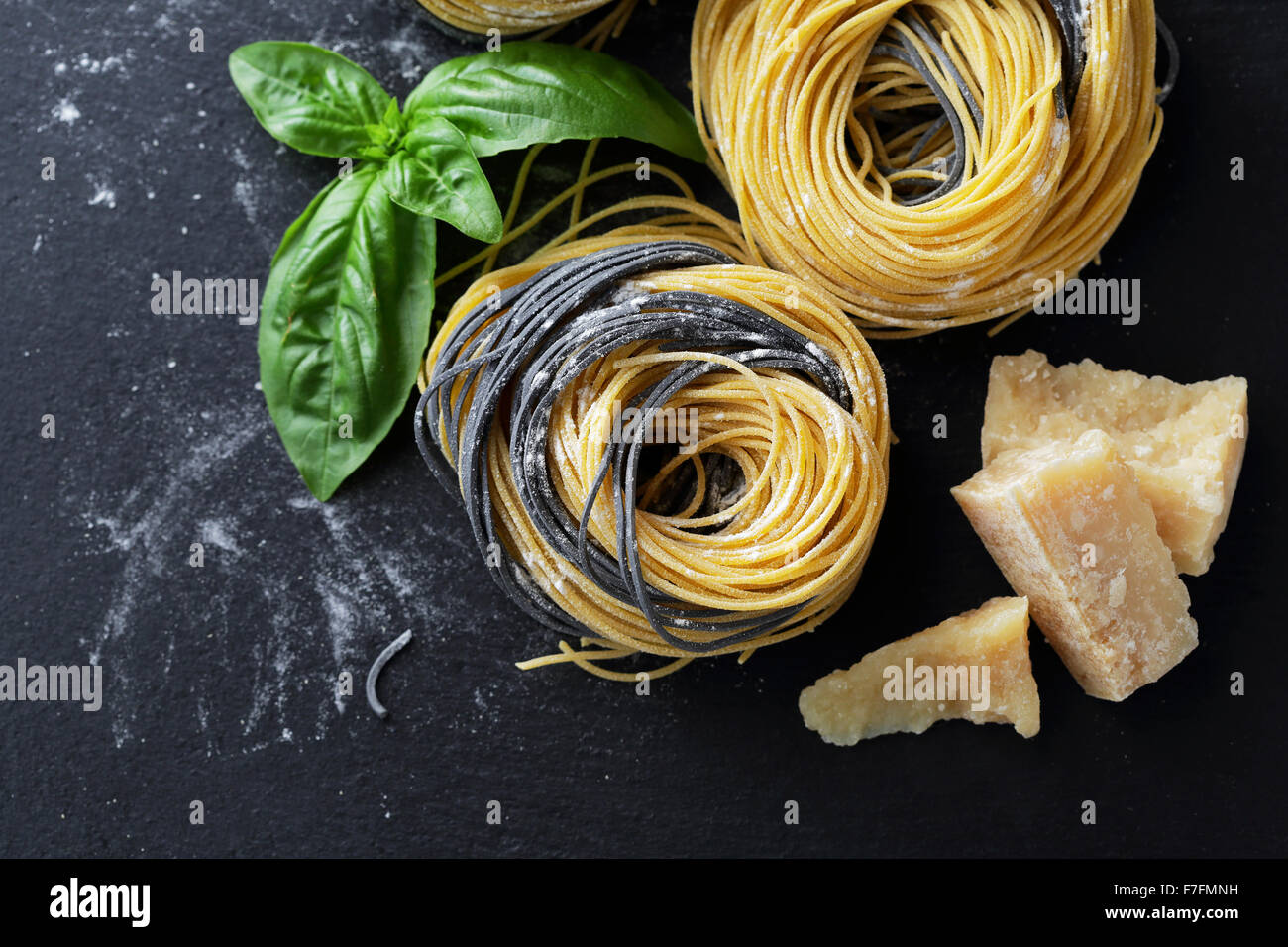 raw pasta on slate, food top view - Stock Image