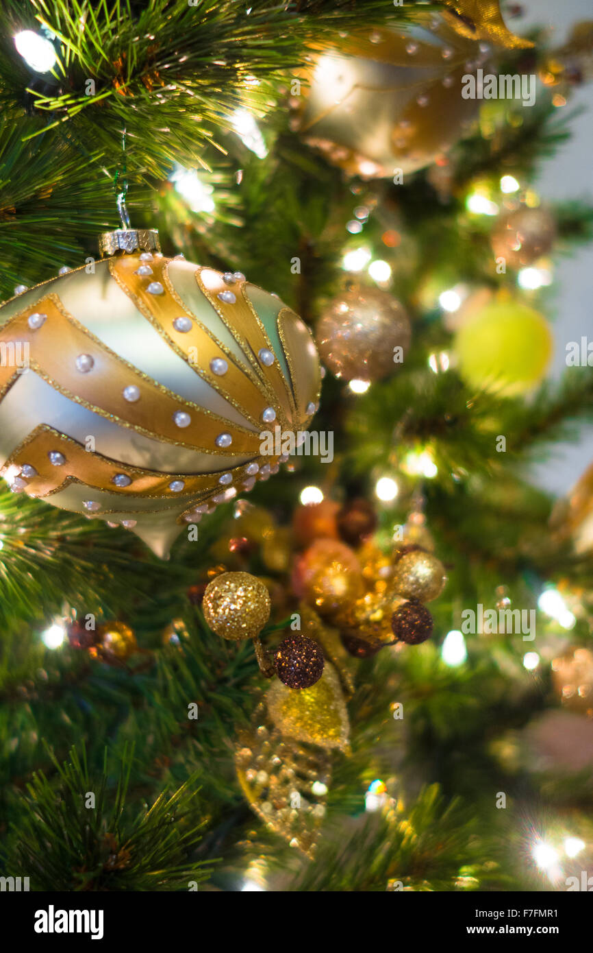 beautiful christmas ornaments are hung on an elegant christmas tree with white lights stock