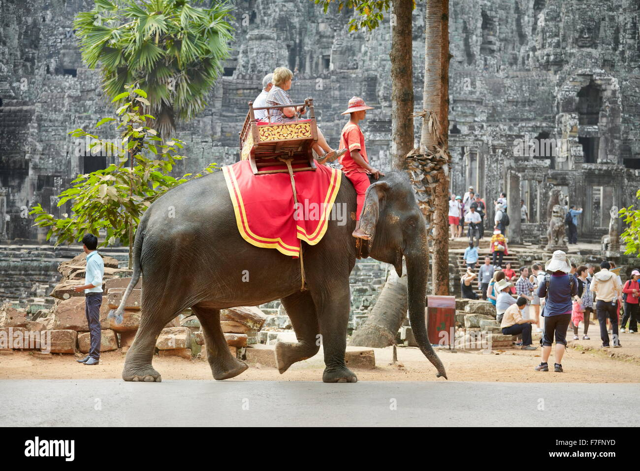 Tourists on elephant ride, Bayon Temple, Angkor Thom, Cambodia, Asia - Stock Image