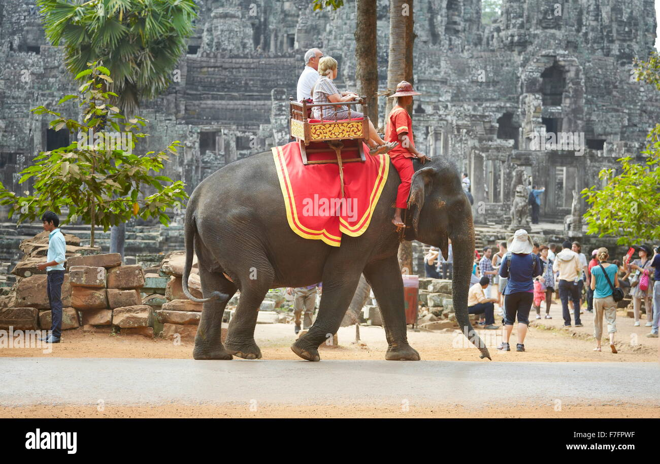 Angkor - tourists ride on elephant, Bayon Temple, Angkor Thom, Cambodia Stock Photo