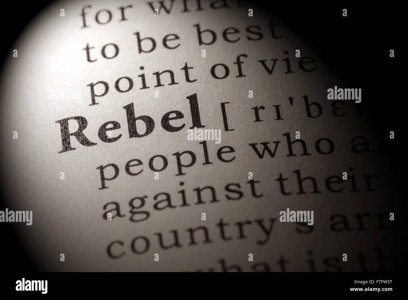 fake dictionary, dictionary definition of the word rebel stock photo