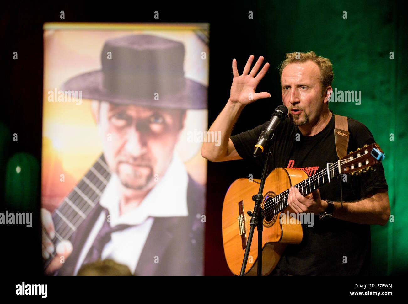 Entertaining artist Helmut Sanftenschneider performs his show 'RuhrpottBanderas'. - Stock Image