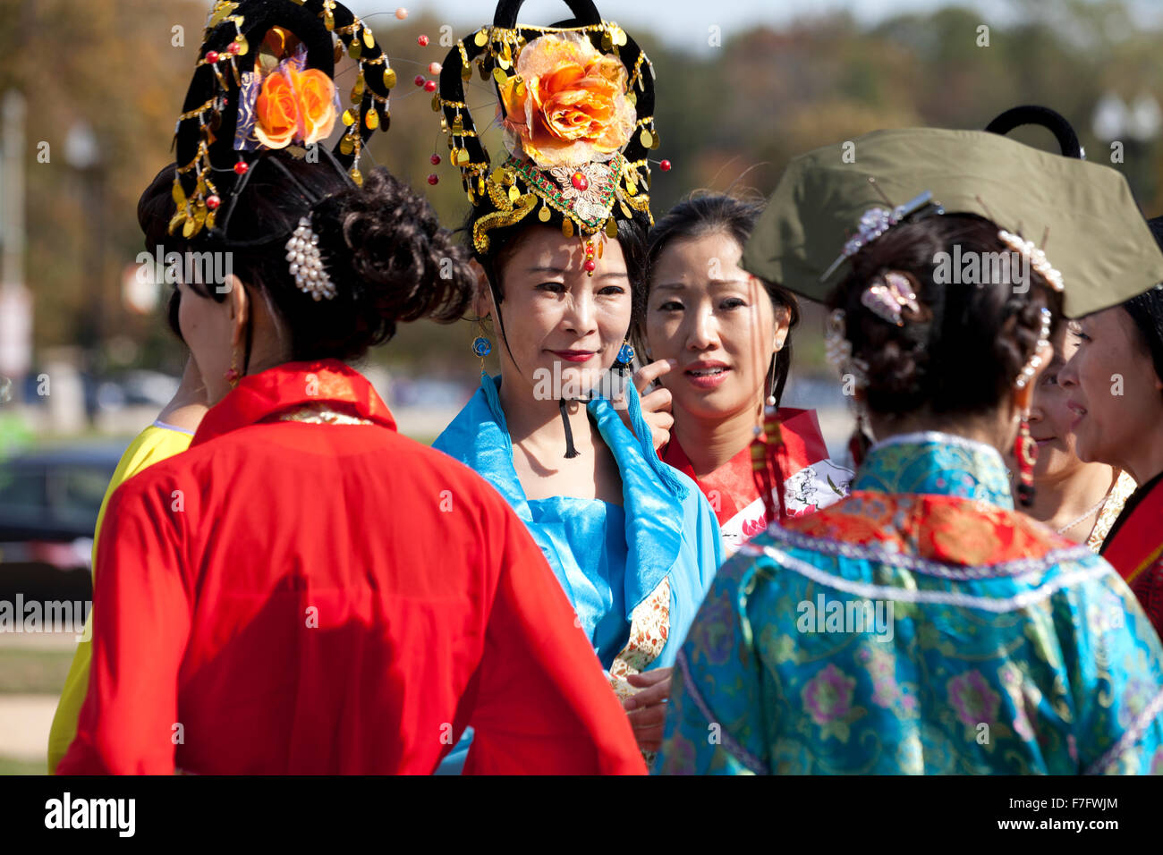 Female Chinese traditional dance performers in costume at Asian festival - USA - Stock Image
