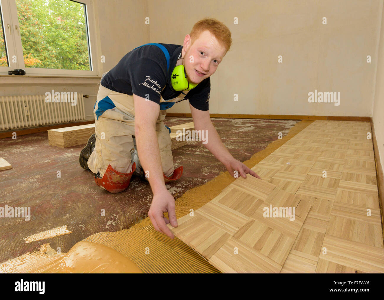 A parquet layer does his job. - Stock Image