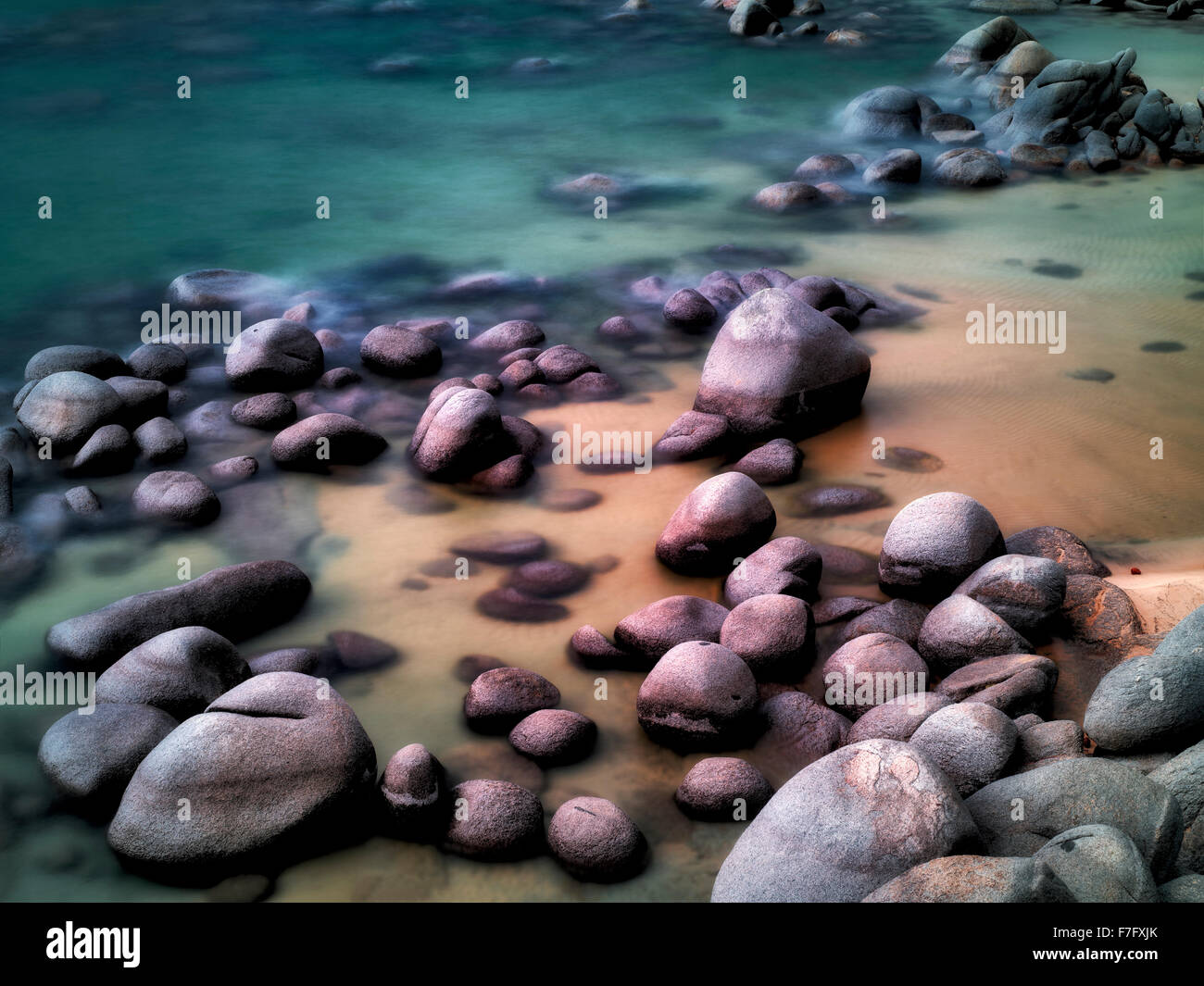 Boulders on beach shore of Lake Tahoe, Nevada - Stock Image