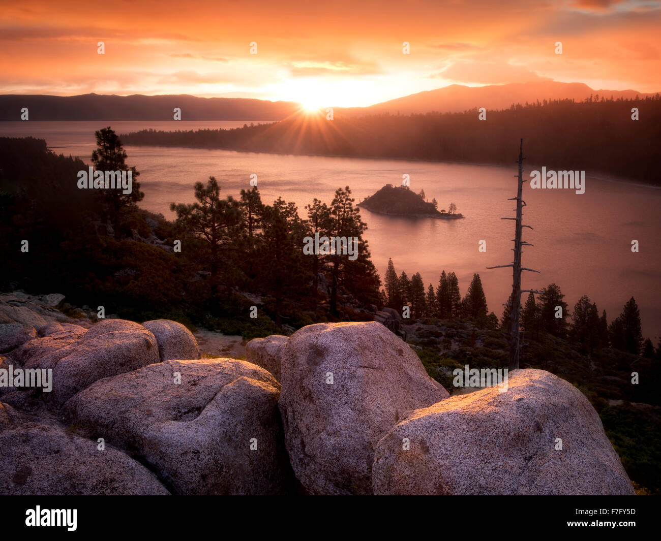 Sunrise and granite boulders at Emerald Bay, Lake Tahoe, California - Stock Image