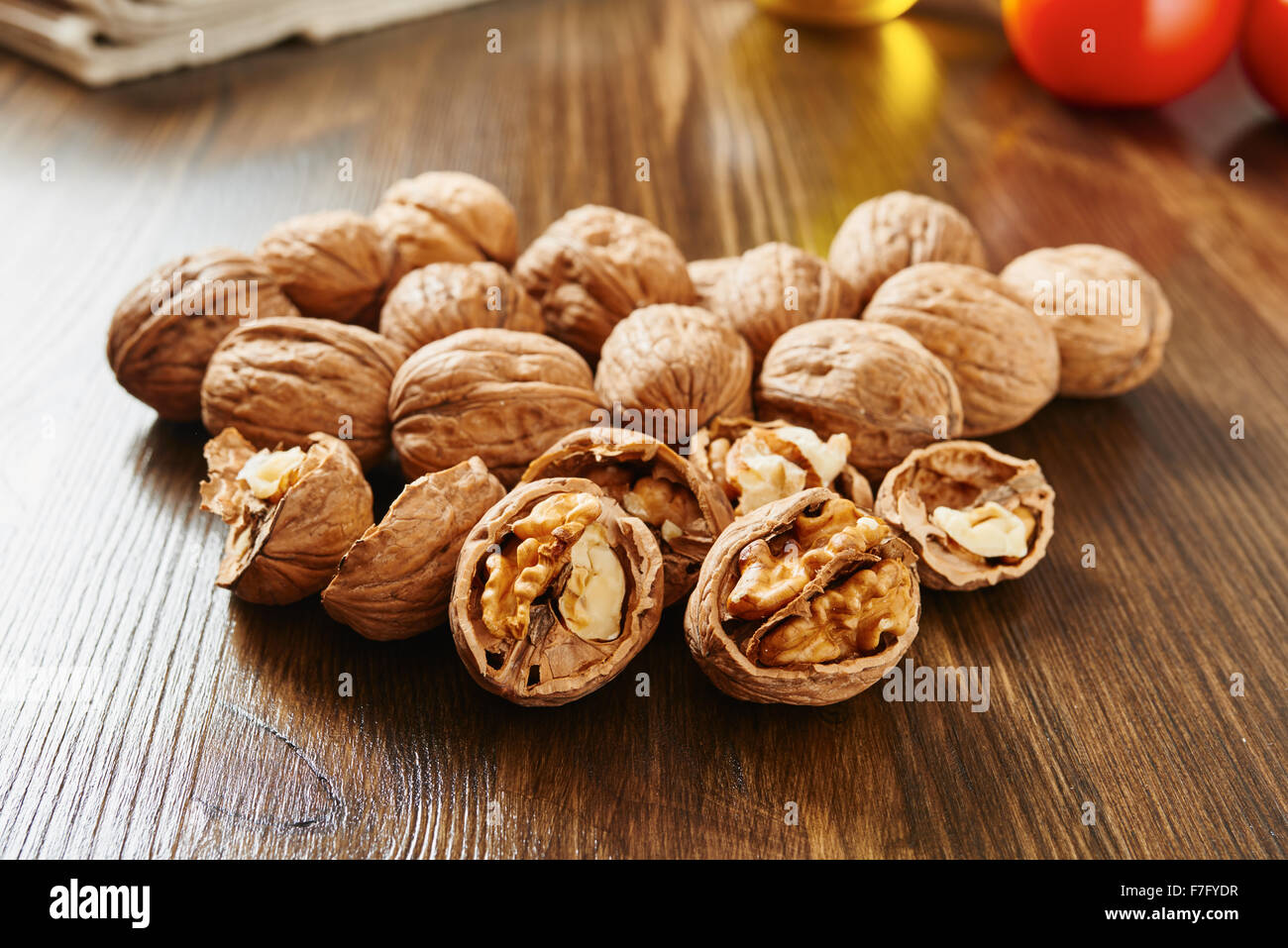Walnuts on wooden table close up Stock Photo