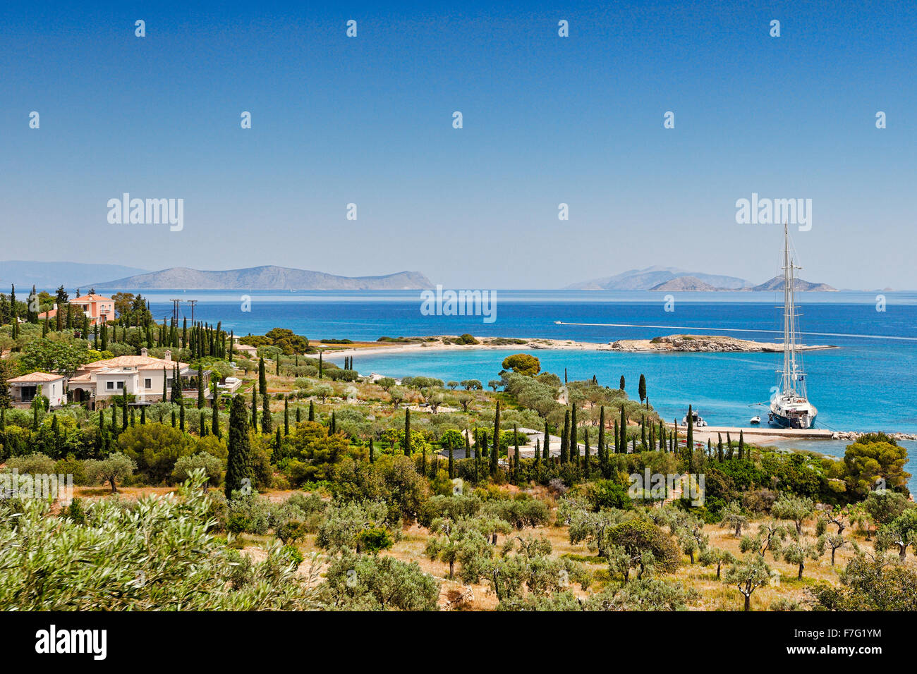 Country houses with harbor on the south side of Spetses island, Greece - Stock Image