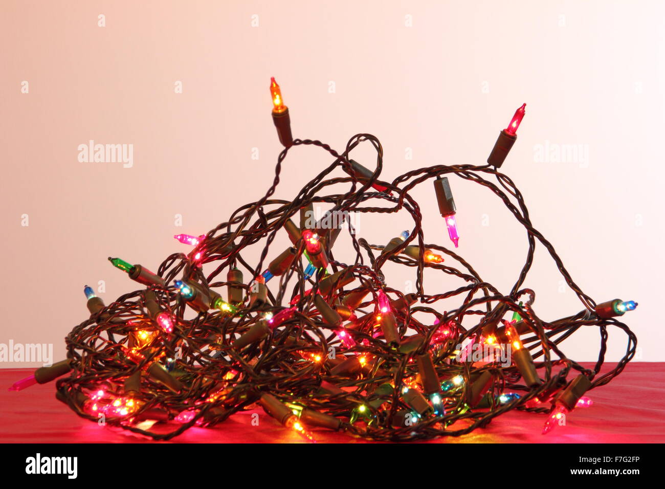 A tangle of indoor Christmas fairy lights in a domestic setting - England - Stock Image