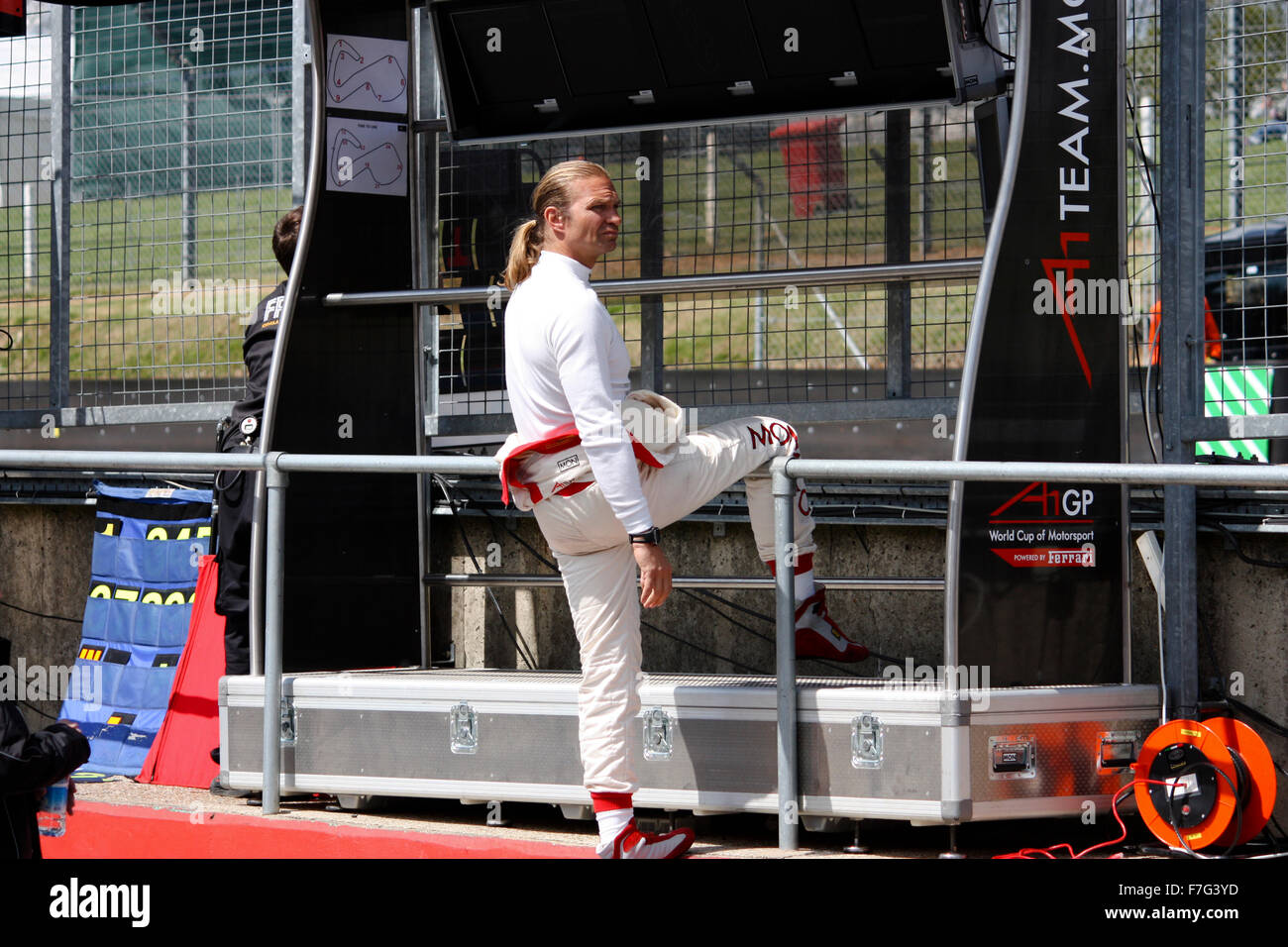 Racing driver hanging out and watching the action at Brands Hatch - Stock Image