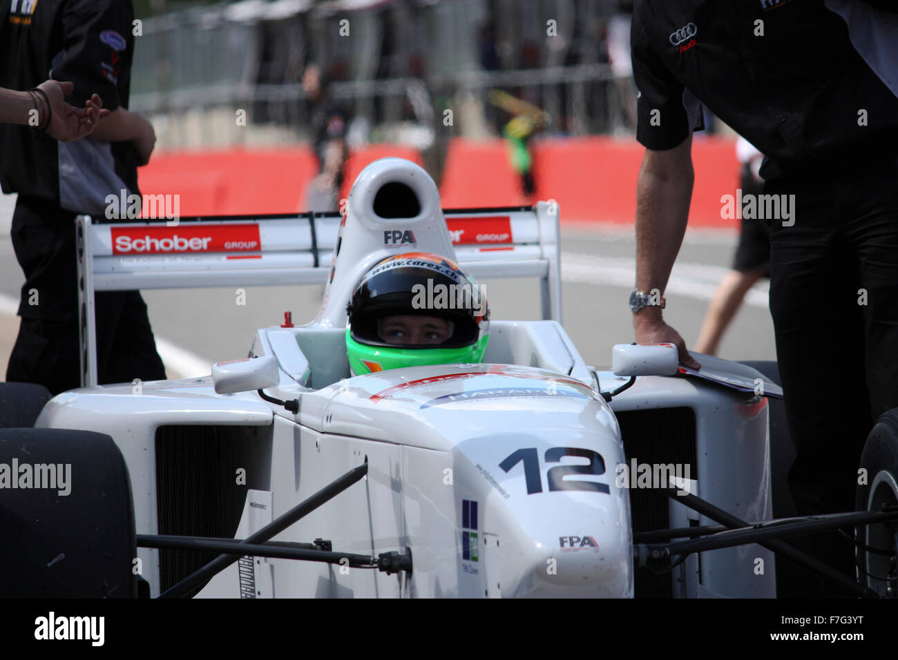 Racing driver in white car - Stock Image