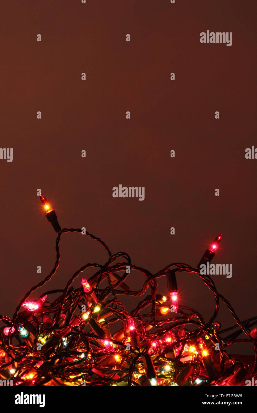 A tangle of indoor Christmas light ina domestic setting - England - Stock Image