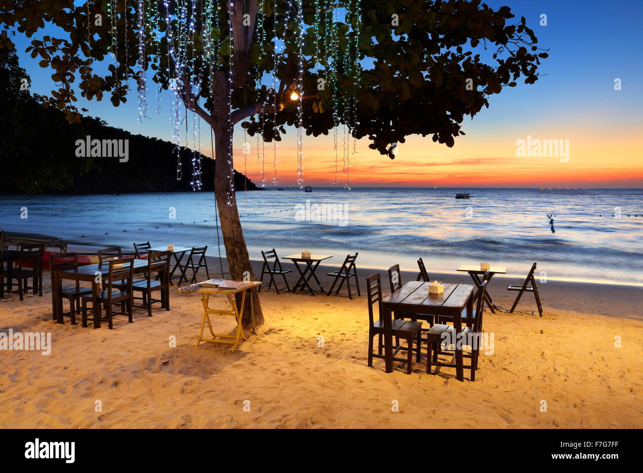 Beach restaurant at sunset, Lima Coco Resort, Ko Samet Island, Thailand - Stock Image