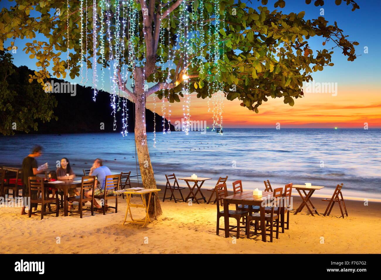 Beach restaurant after sunset, Ko Samet Island, Thailand - Stock Image