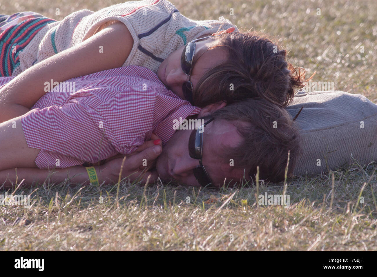 A couple take a nap at the Hop Farm music festival July 2009 - Stock Image