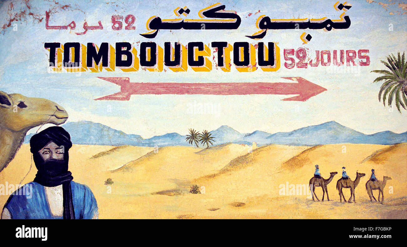 A painted sign of the desert pointing to Timbuktu from Zagora in Morocco, North Africa Stock Photo