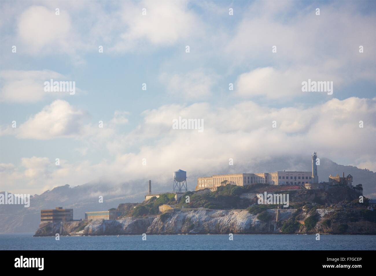 San Francisco's Fisherman's Wharf viewed from the water on a beautiful afternoon.  Alcatraz in late afternoon - Stock Image