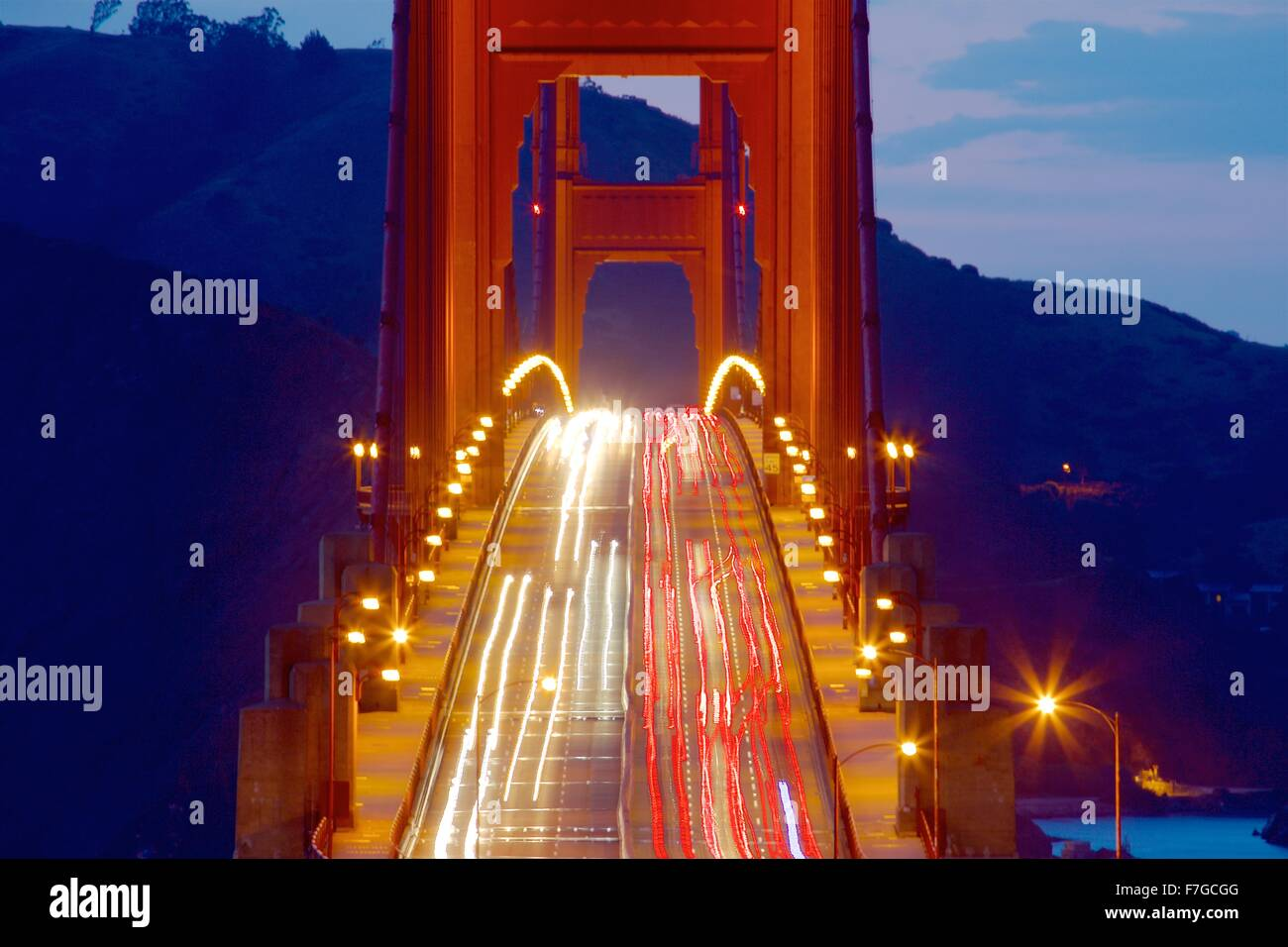 Golden Gate Bridge with commute traffic at night  Commute traffic at night in San Francisco, California - Stock Image